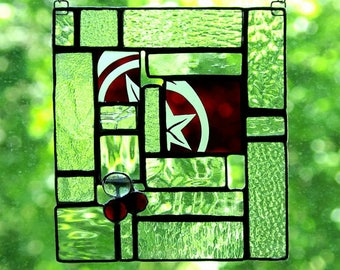 Stained glass panel lightcatcher in red with star, beads and textured clear antique glass