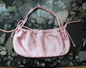 BCBG MAXAZRIA Soft Shell Pink Satin Small Evening Bag. Snap Closure. Size:  11 inches by 5 inches