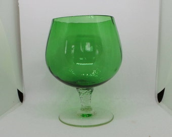 Green brandy or cognac glass with clear twisted stem . Vintage glass