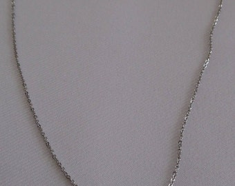 Minimalist stainless steel chain, Pearl green peridot encrusted with crystals.
