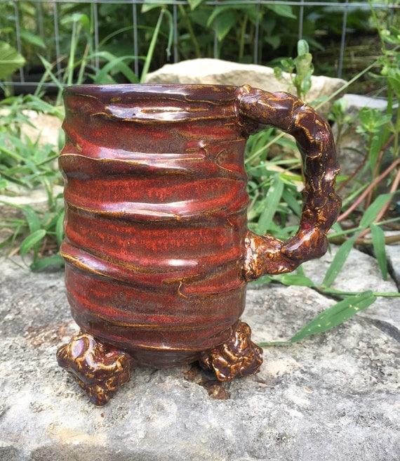 satin red, black, and tan tripod mug