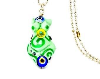 Green swirl goddess, finished pendant