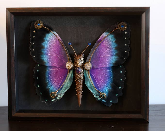One of a kind steampunk butterfly sculpture with purple, blue and black wings