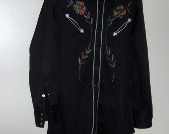 "70s polyester Johnny West men shirt black  with embroidery extra long tail tapered approx 20"" from armpit to armpit and approx 32 1/2 "" long"