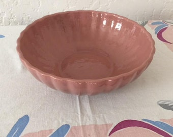 LARGE PINK BOWL from the 1950s that is ribbed all the way around. Perfect size for salad or fruit or centerpiece decoration.