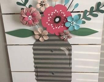 Metal flower mason jar on pallet wood frame, mother's day, spring,corrugated metal