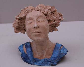 A happy woman: terracotta sculpture