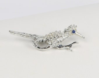 1960's Silver Tone Roadrunner Pin with Blue Crystal Eye. Excellent Condition. Rollover Clasp.