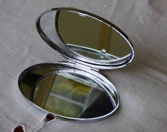 Pocket mirror oval silver color