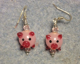 Light and hot pink lampwork pig bead earrings adorned with pink Chinese crystal beads.