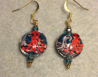 Turquoise and red lampwork octopus bead earrings adorned with turquoise Chinese crystal beads.