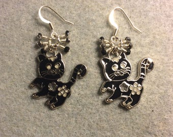 Black enamel cat charm earrings adorned with tiny dangling black and silver Chinese crystal beads.