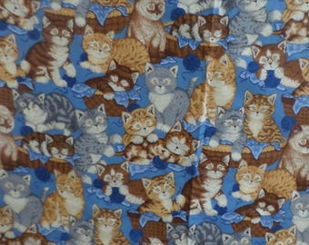 Cat Fabric from VIP Cranston Print Works that has cats sleeping and playing  that is 22 onches by 44 inchers wide that is cotton
