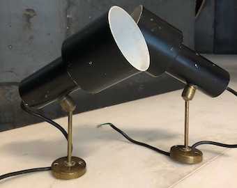 Set of two armed wall lamps designed by Giuseppe Ostuni for Oluce from the 50s.