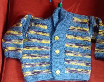 Hand knitted cardigan to fit a child aged 6-9 months old