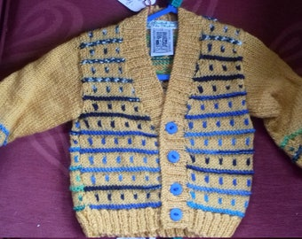 Hand knitted,  Merino wool cardigan to fit a child aged 6-9 months old