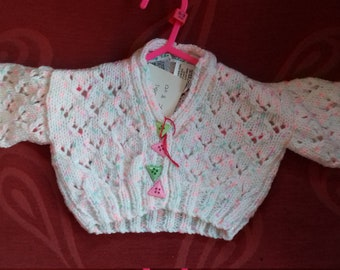 Hand knitted, traditional style cardigan to fit a baby girl aged 0-3 months old