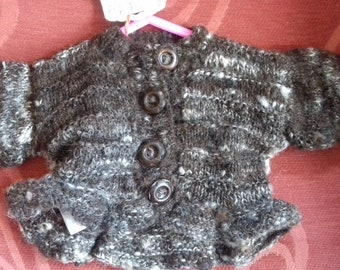 Hand knitted cardigan, knitted with home spun wool to fit a newborn baby girl