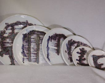 White Stoneware Plates with Metallic Silver Black Underglaze Tectonic Decoration with Cobalt Blue and Iron Red Highlights