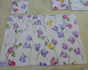 Placemats & coasters.  Set of 6. Pretty Flowers Print.  Sturdy cotton fabric.   Fully washable.   Pretty, fun and practical.