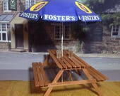 Dolls house OOAK miniature handmade wooden picnicpub table with fosters umbrellaparasol and two drinks  112 scale