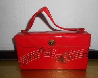 50s handbag red with notes and game clock