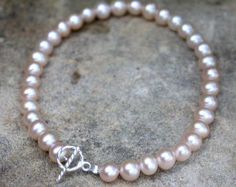 Small soft pink round pearl bracelet finished with sterling silver clasp