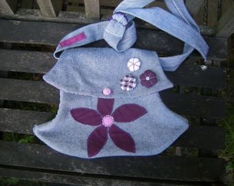 Light blue recycled jean shoulder bag and fabric flowers.