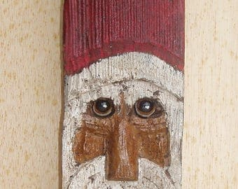 Primitive African-American Santa carved from reclaimed fence rail