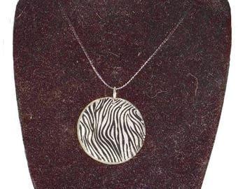 Necklace round black and white Zebra