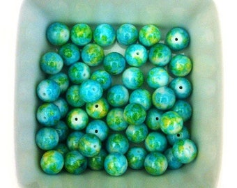 Set of 20 light blue floral 10mm round glass beads