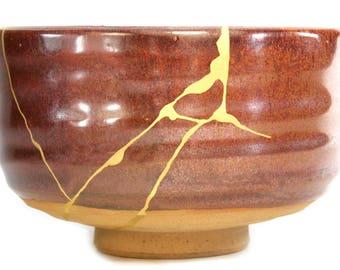 red iron glaze chawan Kintsugi tea ceremony bowl gold Urushi