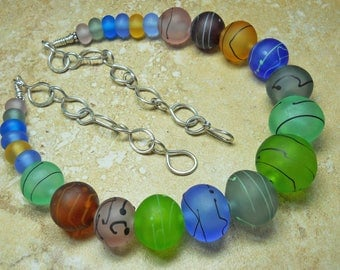 Multi color etched lampwork glass necklace with black trailing & Sterling silver chain and clasp