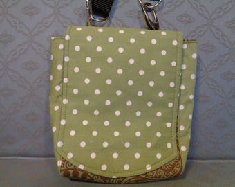 Travel shoulder/crossbody bag, green spot fabric, plenty of zipped pockets and a clip on belt or strap safe place for passport and cash.