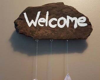 """Stained wooden """"Welcome"""" sign with crystals"""