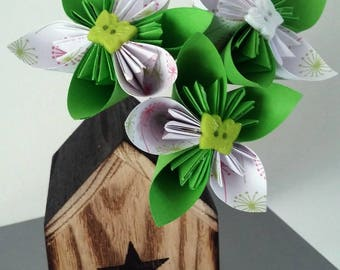 wooden house with origami bouquet vase