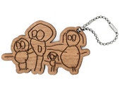 Accessory or Keychain made with a child's drawing. The coloring is engraved and laser cut. Wood color and fastener to choose.