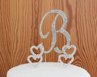 "The letter ""B"" cake topper in gorgeous silver crystal rhinestone with 2 double crystal rhinestone hearts for weddings anniversary birthdays"