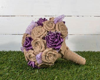 A Handmade Rustic/Vintage Style Bridal Bouquet with Hessian Ribbon Roses, Purple Satin Roses, Purple Lace and Pearl Beading