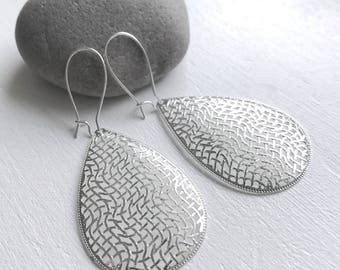 Dangle Silver earrings with design engraved pendant