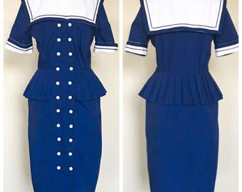 Navy blue, button-down, peplum dress. Women's US size 8.