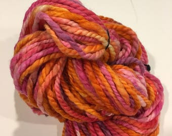 Orange and pink hand dyed yarn