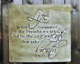 """Life is not Measured, is a metal laser cut sign with a natural finish. It measures 16"""" x 15"""""""