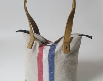 Kleine luiertas/upcycling/YKK rits afsluitbaar/handgemaakt /originele linnen Nederlandse postzak/waxed canvas schouderbanden.