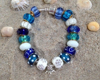 Blue and white charm's adult size bracelet