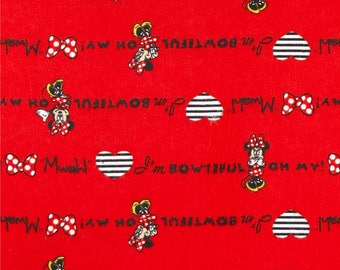"Minnie Mouse on red flannel fabric, 42"" wide, 100% cotton"