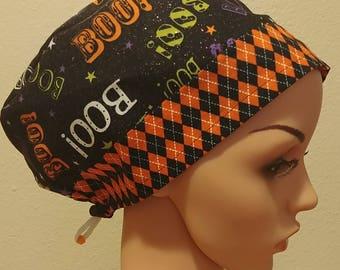 "Women's Surgical Cap, Scrub Hat, Chemo Cap, Glittery Halloween ""BOO"" with Orange and Black Diamond Band"