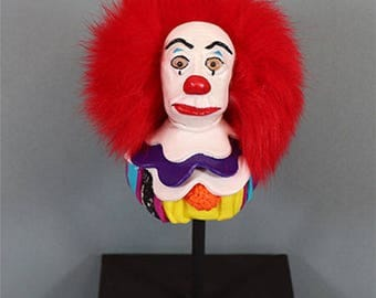 PennyWise the clown from Stephen King. Decorative bust on pedestal