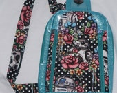 Glitter and Polka Dots Floral Wars Speedwell sling bag