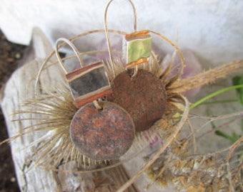 Rusty steel discs  and sterling eardangles